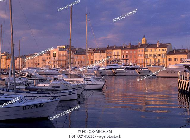 France, St. Tropez, Cote d' Azur, Provence, harbor, Var, Europe, Yachts docked in the harbor of Saint Tropez at sunset on the Mediterranean Sea