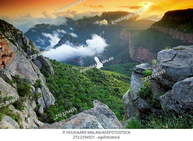 Landscape photo of a colourful sunrise over the depths of Blyde River Canyon. Mpumalanga, South Africa