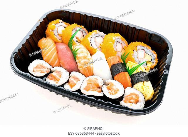 Seafood sushi japanese food style with California roll maki , Salmon Sushi , Tuna Sushi , Shrimp Sushi , Squid sushi , Sweet egg sushi and Etc in black box...