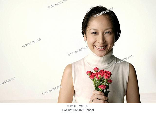 Young woman with roses, portrait