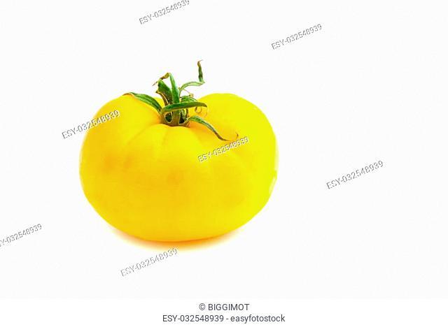 single yellow tomato closeup on white background