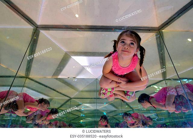 Little child (girl age 05) inside Mirror maze