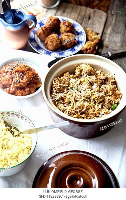 Chicken byriani, sweet potato bhajis and chicken jalfrezi (India)