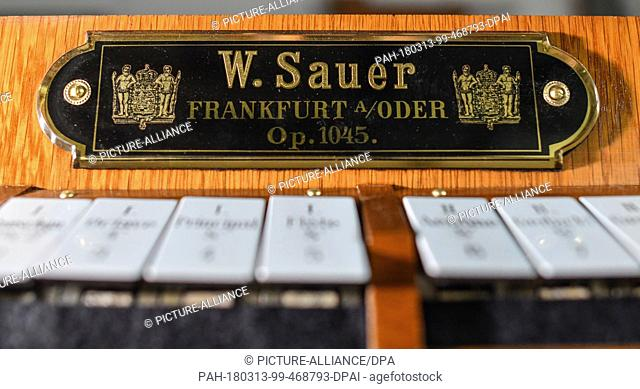 13 March 2018, Muellrose, Germany: Company label from the company W. Sauer Organ Build Frankurt (Oder) Ltd on a console of an organ built in 1910 from the...