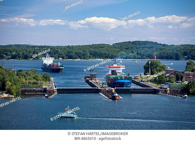 Shipping with container ships at the Holtenau Lock, Kiel Canal, Kiel, Schleswig-Holstein, Germany