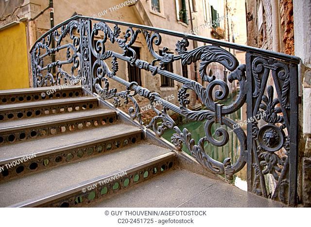 a metal bridge over a canal, Venice, Venetia, Italy