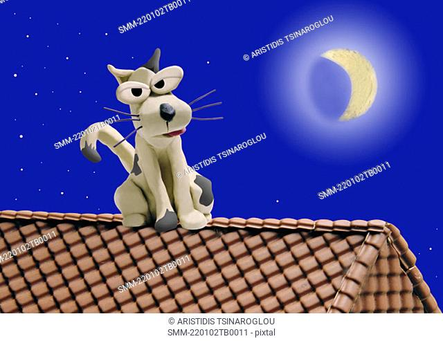 Dog on a roof in moonlit night
