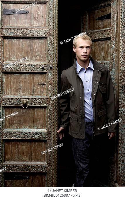 Caucasian man standing in ornate doorway