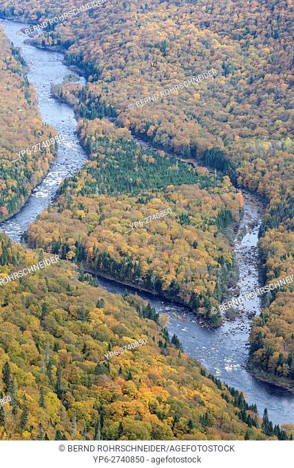 river and autumnal forest, Jacques-Cartier National Park, province Quebec, Canada