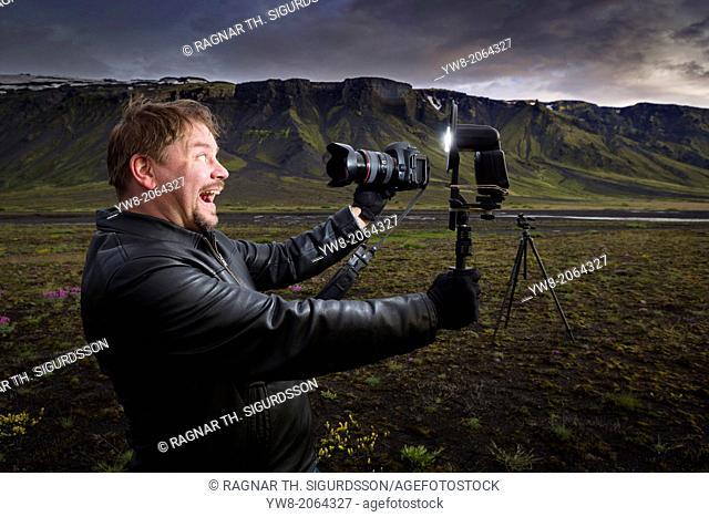 Photographer taking self portrait, South Coast, Iceland