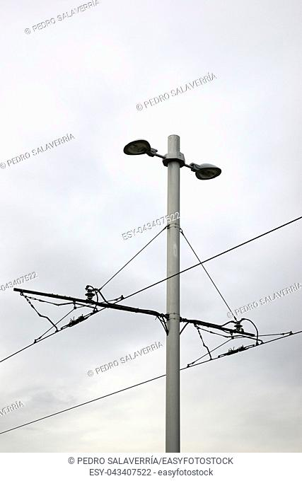 Detail of a catenary and stormy sky