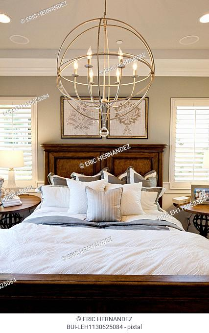 Electric candle chandelier in bedroom; Rancho Mission Viejo; California; USA