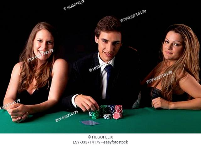 Young handsome man playing texas hold'em poker
