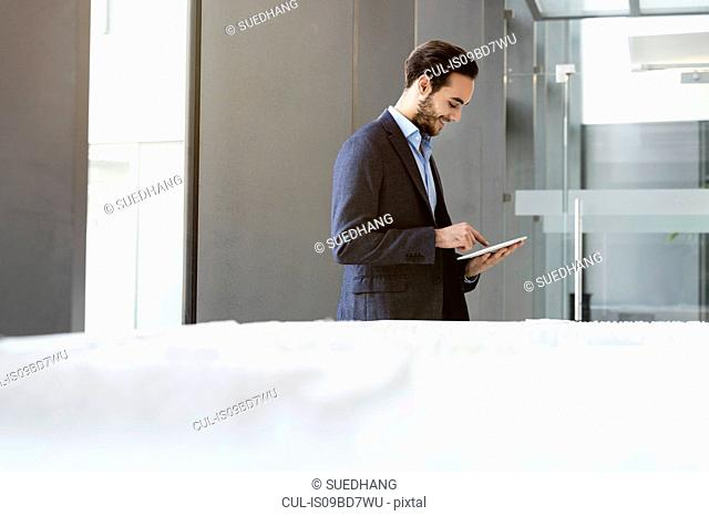 Businessman in office using digital tablet
