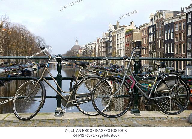 Two bicycles on a canal bridge in Amsterdam
