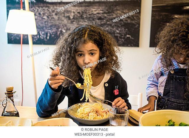 Little girl eating tasty spaghetti