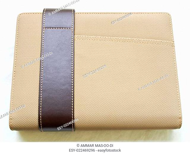 Light brown leather organizer isolated on white