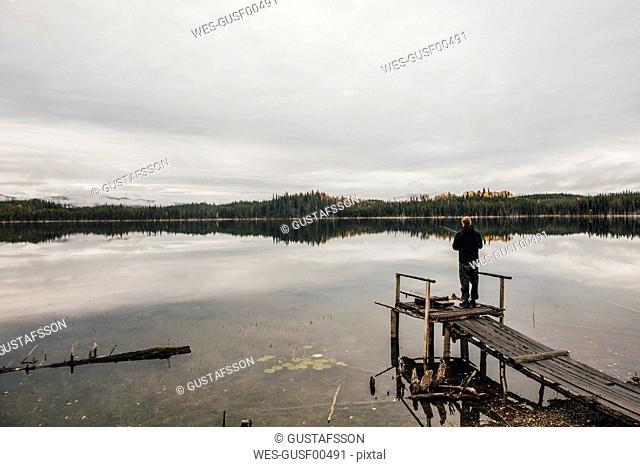 Canada, British Columbia, man fishing at Blue Lake