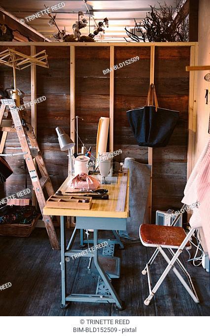 Sewing machine on seamstress desk in rustic studio