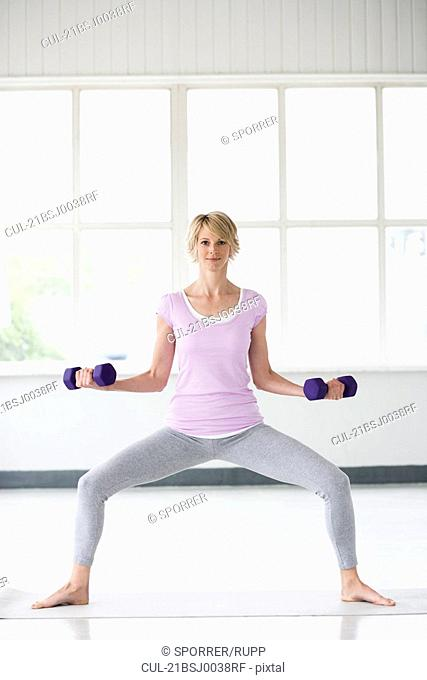 Woman exercising with weights