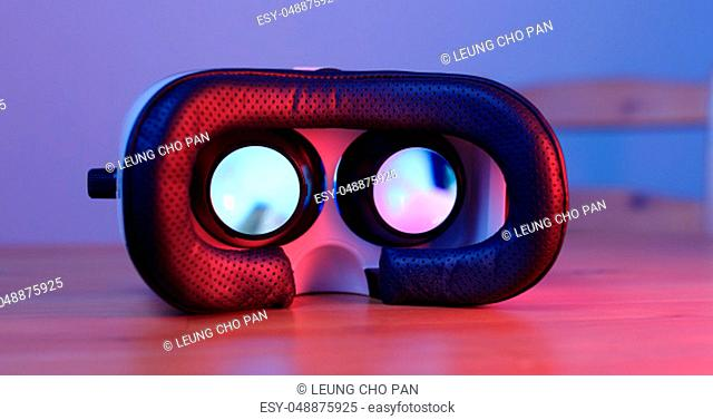 Virtual reality device with purple and blue light
