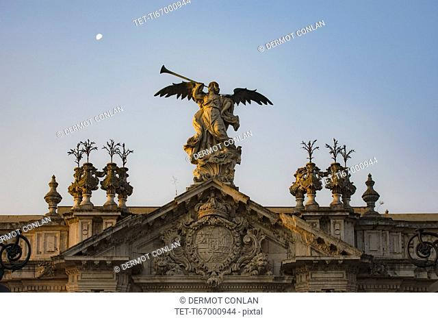 Spain, Seville, Statue of angel with trumpet