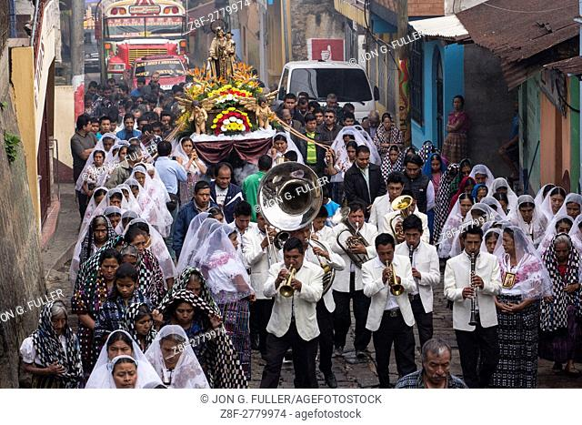 Catholic procession of the Virgin of Carmen in San Pedro la Laguna, Guatemala. Women in traditional Mayan dress with white mantillas over their heads