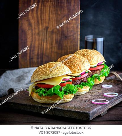 hamburger with beef, onion, tomato, lettuce, cheese and spices. Fresh burger