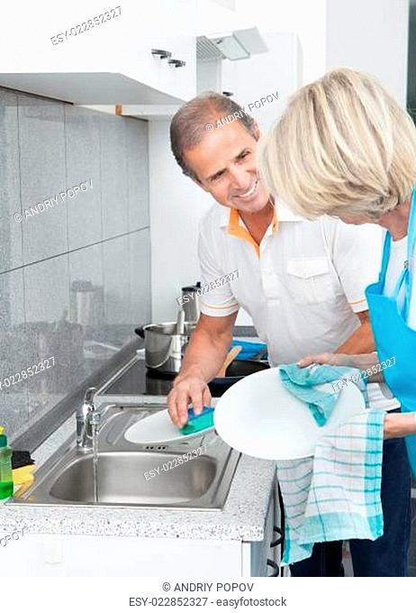 Mature Couple Cleaning Utensils