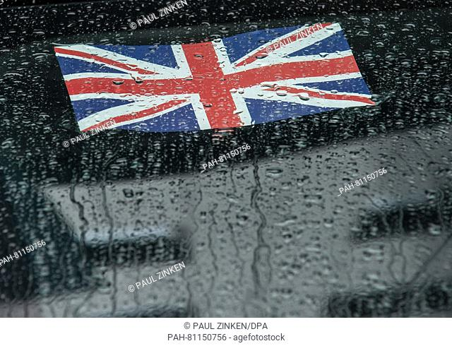 FILE- A file picture dated 23 June 2015 shows a British national flag seen on a car window at the British embassy in Berlin,Germany