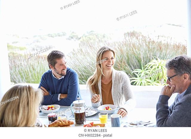 Couples enjoying breakfast on beach patio