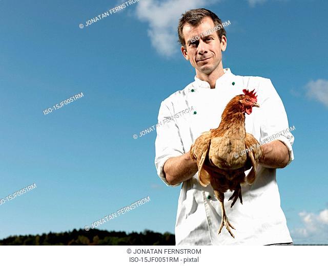 Chef holding hen