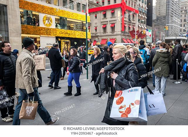 Shoppers on Fifth Avenue in New York looking for bargains on Black Friday, the day after Thanksgiving. Many retailers, including Macy's