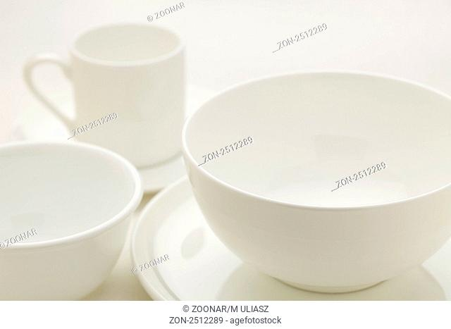 white china bowls and coffee cup, selective focus abstract
