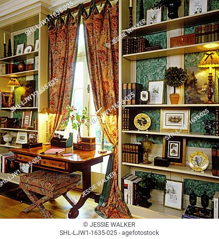 WINDOW TREATMENTS: Tab tie full length curtains between two built in bookcases, rich green print fabric, french doors