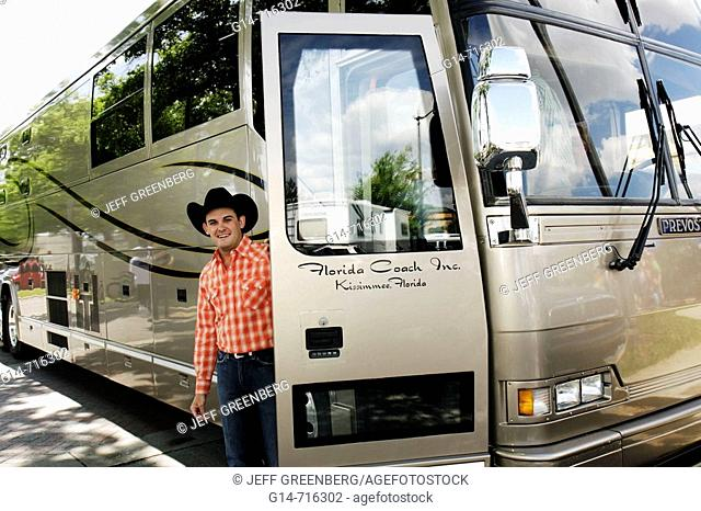 Florida, Kissimmee, Toho Square, Kowtown Festival, annual cowboy heritage celebration, country music, performer, singer, Kenyon Lockry, tour bus, motorhome