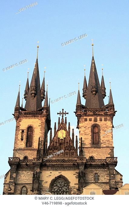 Church of Our Lady in front of Týn stands on the Old Town Square barricaded behind a row of  houses.  Across from it stands the Old Town Hall