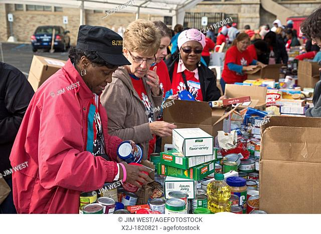 Detroit, Michigan - Members of the United Methodist Church sort and pack food that their congregations have collected for the Gleaners Community Food Bank...