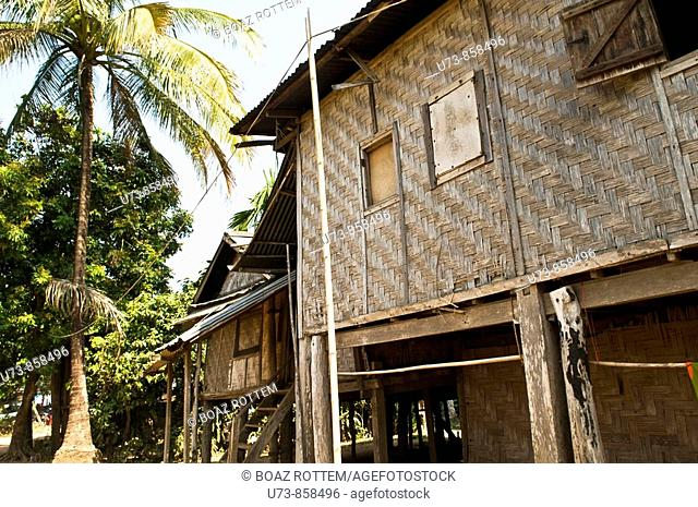 Traditional Lao houses along the Mekong river in Laos  the houses are usualy built on stilts as it rains a lot and the river might overflow