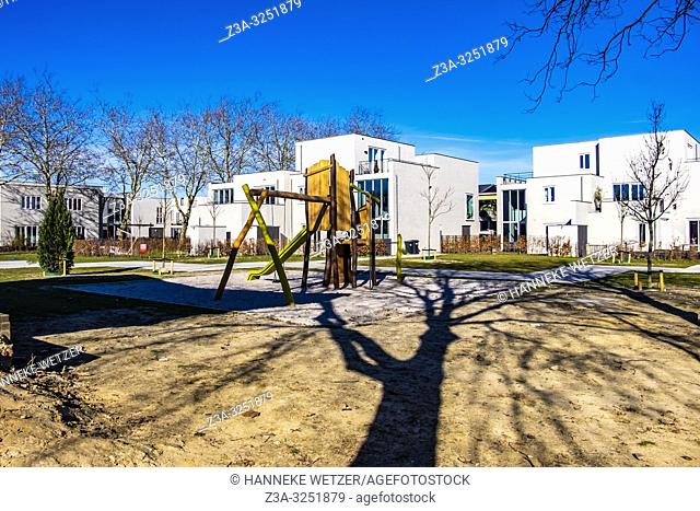 Playground at residential Strijp-R with modern homes on the old factory site Philips, Eindhoven, The Netherlands
