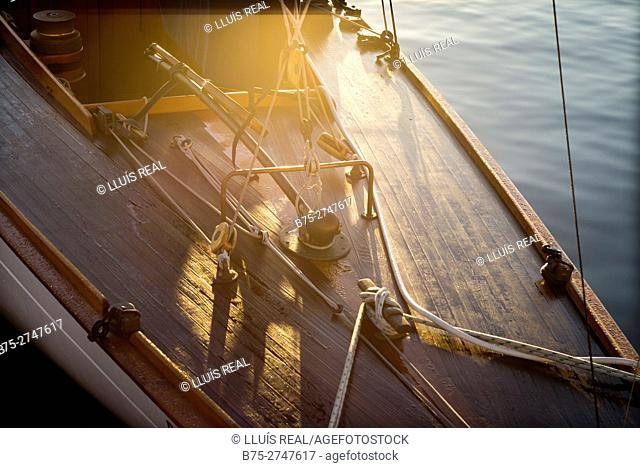 Moored vintage sailboat in the early morning, detail of stern. Port of Mahó, Minorca, Balearic Islands, Spain