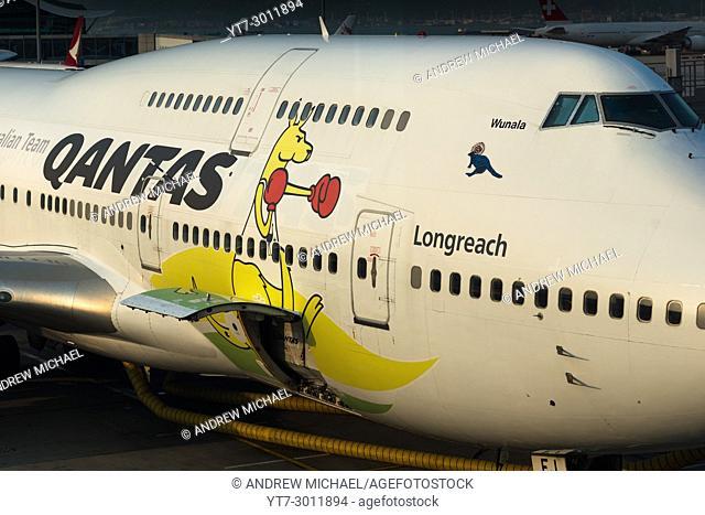Qantas Jumbo jet with kangaroo art. Hong Kong airport, China