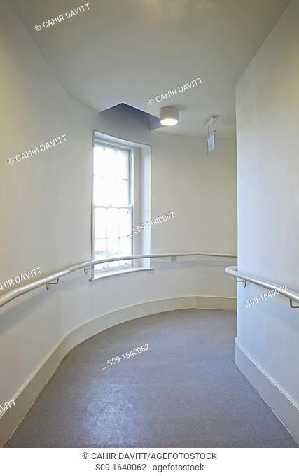 Curved corridor and traditional up and down timber sash window in contemporary office building, Booterstown, Dublin, County Dublin, Ireland