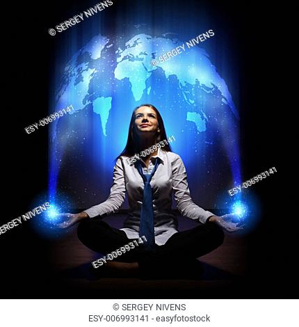 Young businesswoman against blue global technology background
