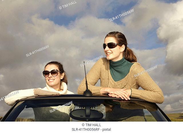 Women standing up in convertible