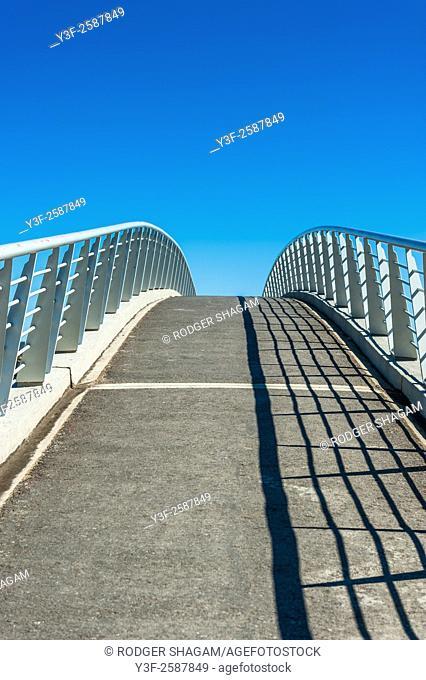 A pedestrian walkway/bridge for crossing a highway