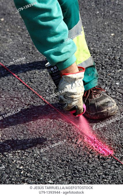 Painting the road worker