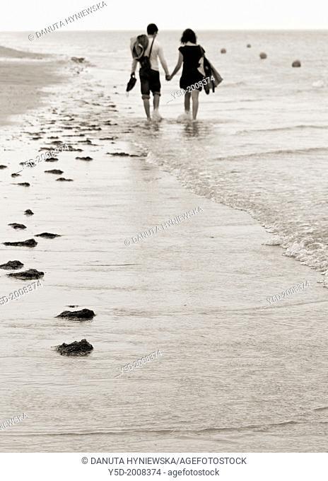 young couple walking hand in hand at the seaside, sandy beach, Atlantic Ocean, Honfleur, Calvados, Basse Normandie, Normandy, France