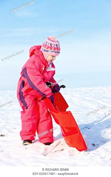 little girl with bob in snow