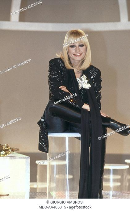 Raffaella Carrà seated in the studio of Millemilioni. Italian TV presenter, actress, singer and showgirl Raffaella Carrà (Raffaella Maria Roberta Pelloni)...